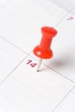 Calendario y chincheta Fotografía de archivo libre de regalías