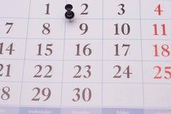Calendario y paperclip Foto de archivo