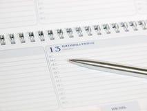 Calendario y pluma. viernes 13 Fotografía de archivo libre de regalías