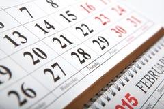 Calendarios de pared puestos en la tabla Fotografía de archivo libre de regalías
