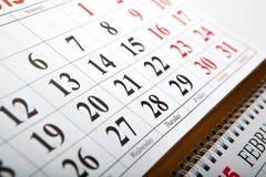 Calendarios de pared puestos en la tabla Foto de archivo libre de regalías