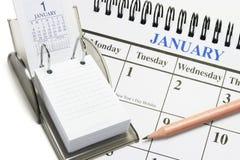 Calendarios y lápiz imagen de archivo libre de regalías