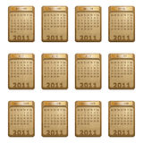 Calender for 2011. In wood design with plaques isolated on white Stock Image