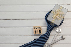 Calender date by gifts for fathers day on wooden table. Overhead view of calender date by gifts for fathers day on wooden table Stock Images