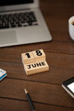 Calender date with laptop on table. High angle view of calender date with laptop on wooden table Royalty Free Stock Photography