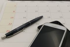 Calender date and telephone in business concept. With a pen Stock Images