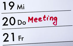 Calender entry, meeting written with red color, close up, detail Royalty Free Stock Photo