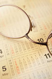 Calender and glasses. Close up of calender and glasses royalty free stock photos