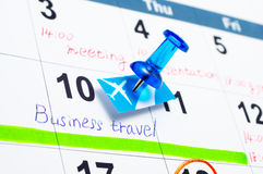 Calender and pushpin. Concept image of scheduling a business travel Stock Image