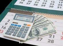 Calendrier, calculatrice et dollars Images libres de droits