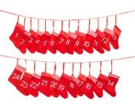 Calendrier 1-24 d'avènement Décoration rouge de bas de Noël Images stock
