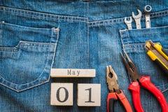 Calendrier de bloc en bois pour le jour de travail, le 1er mai Images libres de droits