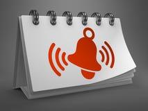 Calendrier de bureau avec l'icône de sonnerie rouge de Bell. Photographie stock libre de droits