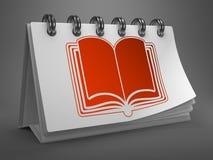 Calendrier de bureau avec l'icône ouverte de livre. Photographie stock libre de droits