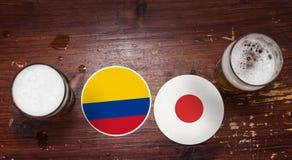Calendrier de match de la coupe du monde 2018, bière Mats Concept Flyer Background La Colombie CONTRE le Japon Images stock