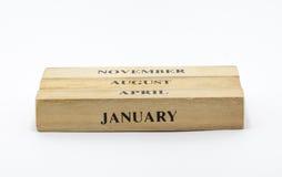 Calendrier en bois cubique de date de style Images stock