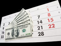 Calendrier et dollars images stock