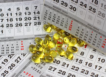 Calendrier et Omega 3 Photo stock