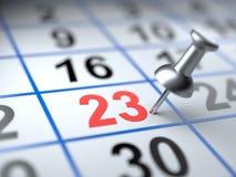 Calendrier et punaise Repère sur le calendrier à 23 photographie stock libre de droits