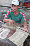Calendrier se vendant dans un village de Bali Photos stock