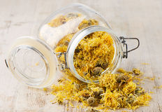 Calendula. Medicinal herbs on wooden table Royalty Free Stock Images