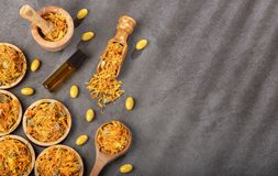 Calendula alternative medicine. Essential oil and pills - Calendula officinalis. Top view stock photo