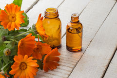 Calendula and bottles with medicines. Concept homeopathy. Royalty Free Stock Image