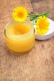 Calendula cream. And calendula flowers Stock Photography