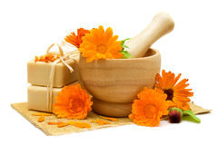 Calendula flowers with bath soap stock photos