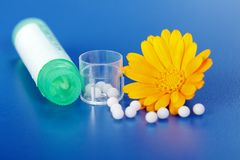 Calendula Officinalis and homeopathic pills Royalty Free Stock Images