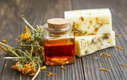 Calendula oil with handmade soaps and dried calendula flowers Royalty Free Stock Photography