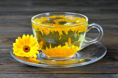 Calendula tea. On wooden background royalty free stock photos