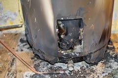Calentador de agua quemado Imagen de archivo
