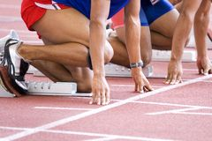 Calentamiento de los atletas Imagen de archivo libre de regalías