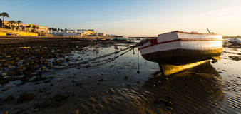 Caleta  Beach with boats in sunny sunrise Stock Images