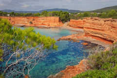 The Caleta Beach in Ibiza, with its red earth Stock Photos