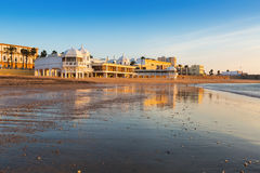 Caleta  Beach in sunny sunrise Stock Photos