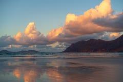 Caleta de Famara beach at sunset, Lanzarote, Canary, Spain royalty free stock photography
