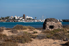 Caleta de Fustes, Fuerteventura, with Lighthouse. Image shows panoramic view to Caleta de Fueste from seaside, Fuerteventura with Lighthouse and a ruin on the Stock Photos