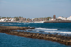 Caleta de Fustes, Fuerteventura, with Lighthouse. Image shows panoramic view to Caleta de Fueste from seaside, Fuerteventura with Lighthouse on the right Stock Photo
