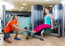Calf extension woman at gym exercise machine Royalty Free Stock Images