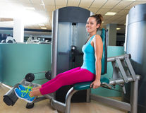 Calf extension woman at gym exercise machine Stock Photo