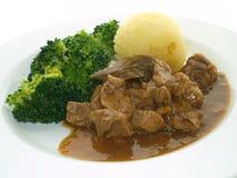 Calf goulash with broccoli Royalty Free Stock Photos
