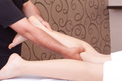 Calf massage Stock Photos