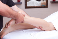 Calf massage. Calf receiving a massage in a spa setting (close up Royalty Free Stock Images