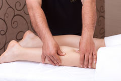 Calf massage Stock Images
