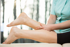 Calf massage Stock Photography