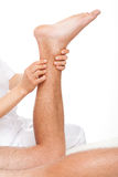 Calf massage Stock Photography
