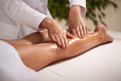 Calf massage in spa Royalty Free Stock Photos