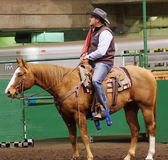 Calf Roping Official On Horseback Royalty Free Stock Images